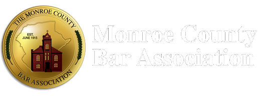 Circular gold and garnet Monroe County Bar Association logo